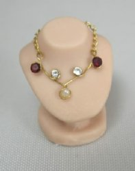 Faux Ruby, Diamond and Pearl Necklace on Display Bust