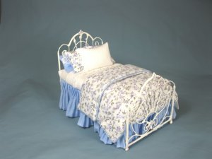 Hand Crafted Metal Bed Dressed in Blue & White