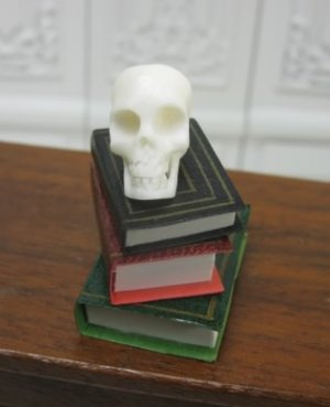Human Skull of Stack of Books