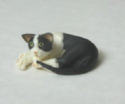 Half-Inch Scale Cat, Black and White, Lying Down