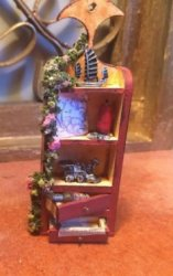 Wooden Curio with Toys and Flowers