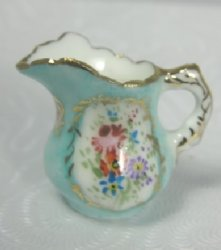 Porcelain Pitcher with Gold Handle