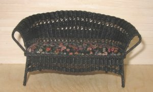 Black Wicker Loveseat with Floral Cushion