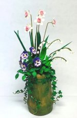 Daffodils, Pansies, and Lilies of the Valley in Clay Pot