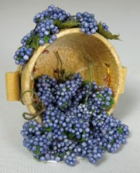 Blue Grapes Spilling from Half Barrel