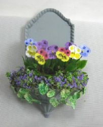 Pansies in Wall Vessel