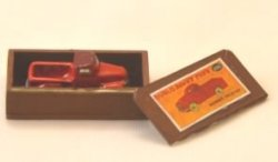 Red Toy Tractor in Red Wooden Box