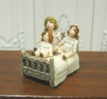 Three Tiny Dolls in Old Fashioned Bed