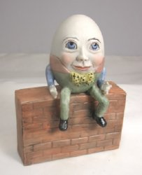 Porcelain Humpty Dumpty Sitting on a Wall