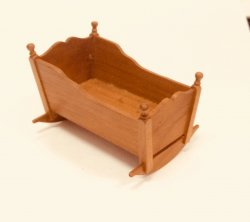 Cherry Wood Cradle with Finials