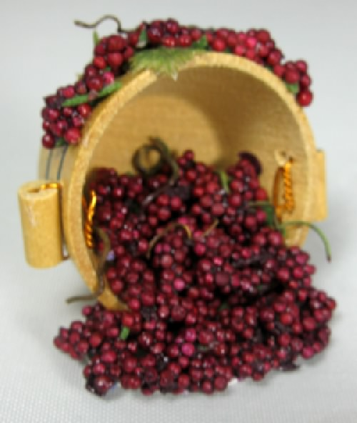 Red Grapes Spilling from Half Barrel